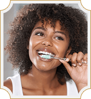 lady enthusiastically brushing her teeth
