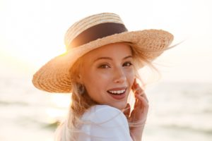 Woman at beach with dental implants